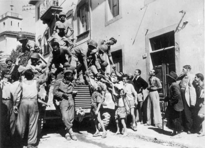 Brazilian soldiers greet Italian civilians in the city of Massarosa, September 1944.