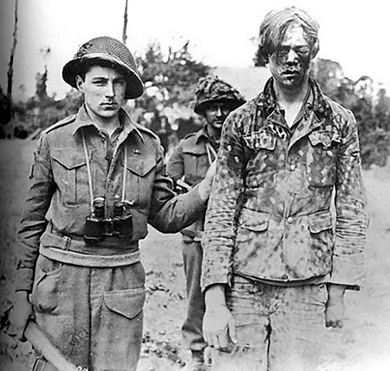 11-a-captured-panzergrenadier-of-the-hitlerjugend-taken-by-a-canadian-intelligence-unit-during-the-fighting-for-caen